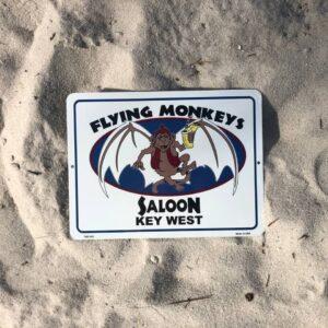 flying monkeys metal sign